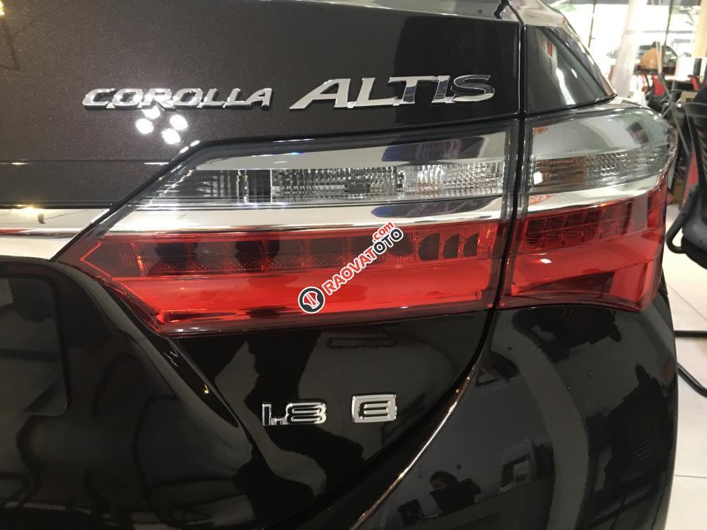 Bán xe Toyota Corolla Altis 1.8E (CVT) màu nâu, giá cạnh tranh, hỗ trợ vay vốn 90%. LH: 0916 11 23 44-7