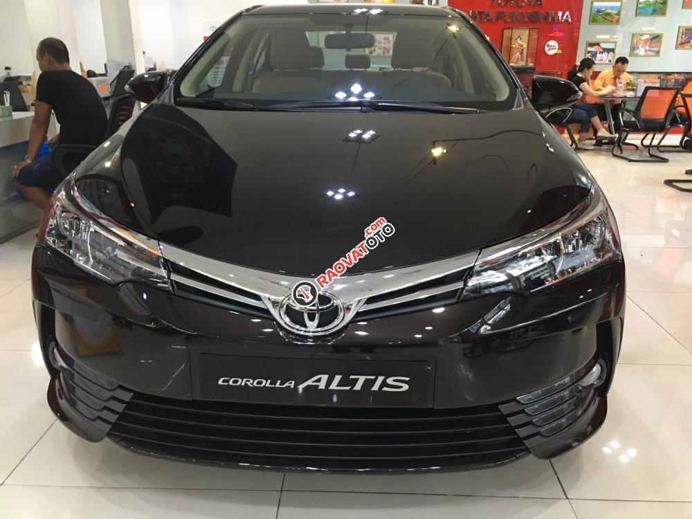 Bán xe Toyota Corolla Altis 1.8E (CVT) màu nâu, giá cạnh tranh, hỗ trợ vay vốn 90%. LH: 0916 11 23 44-0