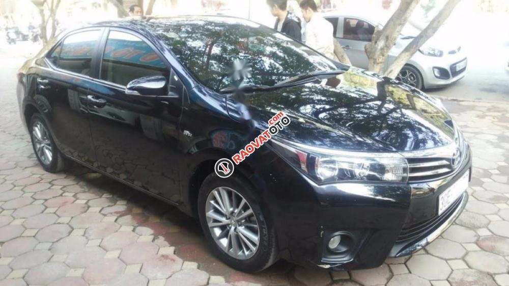 Cần bán lại xe Toyota Corolla altis 1.8AT đời 2016, màu đen-1