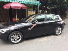 Bán em BMW 116i đời 2013 màu đen, số tự động, 8 cấp