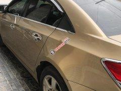 Cần bán xe Chevrolet Cruze LS 1.6 MT đời 2012, màu vàng