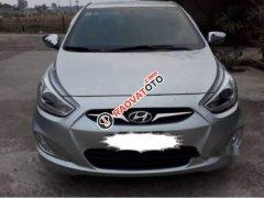 Cần bán Hyundai Accent 1.4 AT 2013, màu bạc, giá 430tr