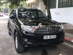Bán xe Toyota Fortuner V 4x4 AT 2014 còn mới đăng ký, chính chủ