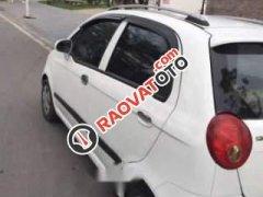 Cần bán xe Chevrolet Spark LT đời 2009, màu trắng số sàn, giá tốt