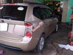 Bán ô tô Kia Carens CRDi 2.0 MT đời 2007, màu vàng,, xe còn mới chưa từng làm đồng