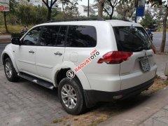 Cần bán xe Mitsubishi Pajero Sport màu trắng sản xuất 2015, số tự động, máy xăng, odo 48000 km