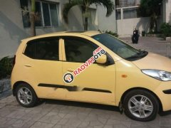Bán ô tô Hyundai i10 đời 2010, màu vàng, đi được khoảng 86.000km