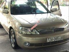 Bán xe Ford Laser sản xuất năm 2003, màu vàng, giá tốt