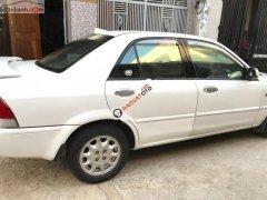 Cần bán xe Ford Laser Delu 1.6 MT đời 2000, màu trắng xe gia đình