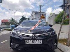 Chính chủ bán ô tô Toyota Corolla altis 1.8G CVT đời 2018, màu đen, nhập khẩu