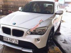 Cần bán xe BMW X1 2010, màu trắng xe gia đình