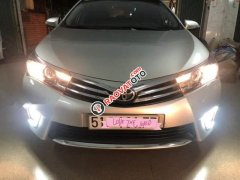 Cần bán Toyota Altis số tự động, màu bạc 1.8, xe đẹp 1 chủ từ đầu, nguyên bản