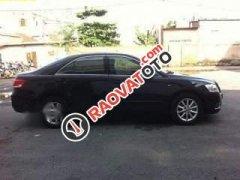 Bán Toyota Camry 2.4G đời 2011, màu đen, còn rất mới