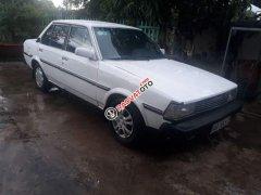 Bán ô tô Toyota Corolla sản xuất năm 1983, màu trắng, nhập khẩu, xe còn đẹp