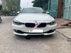 Cần bán xe BMW 320i 2014 ĐK 2015, số tự động màu trắng