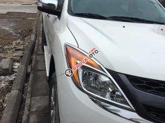 Cần bán xe Mazda BT50 3.2AT 2013 màu trắng, máy dầu 2 cầu.