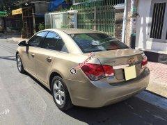Bán Chevrolet Cruze LS 2011 số sàn màu vàng chính chủ