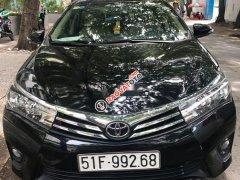 Cần bán xe Toyota Corolla altis 1.8 đời 2015, màu đen, nhập khẩu, xe nguyên bản