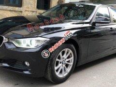 Cần bán xe BMW 320i sản xuất 2012, model 2013 màu đen