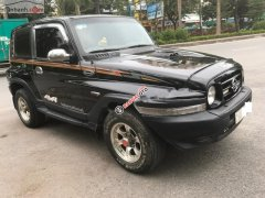 Bán xe Ssangyong Korando TX5 AT 4WD năm 2004, màu đen, xe nhập