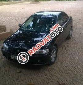 Cần bán gấp Mazda 323 sản xuất 1998, màu đen, 125tr